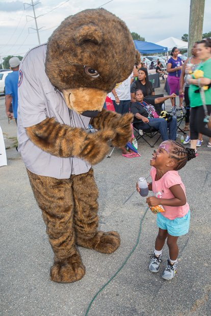 Food, fun and games for National Night Out- Hundreds of people gathered for food, fun and games at the National Night Out event Tuesday night at the Southside Community Center and Sports Complex, 6255 Old Warwick Road. It was one of dozens of events throughout Metro Richmond and across the nation held during the annual August event, which is designed to strengthen ties between citizens and law enforcement. Ayah Yates, 4, shows her delight as she interacts with Care Bear.