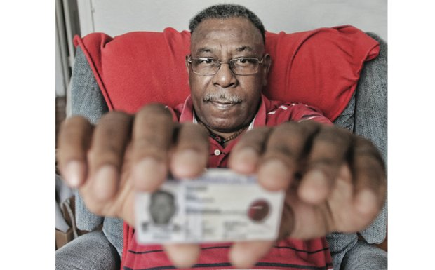 Horace G. Dodd shows off his newly restored driver's license. Virginia DMV had suspended his license in June for failing to pay a North Carolina traffic ticket. The license was restored after a Free Press inquiry led DMV to investigate and determine the suspension was not appropriate.