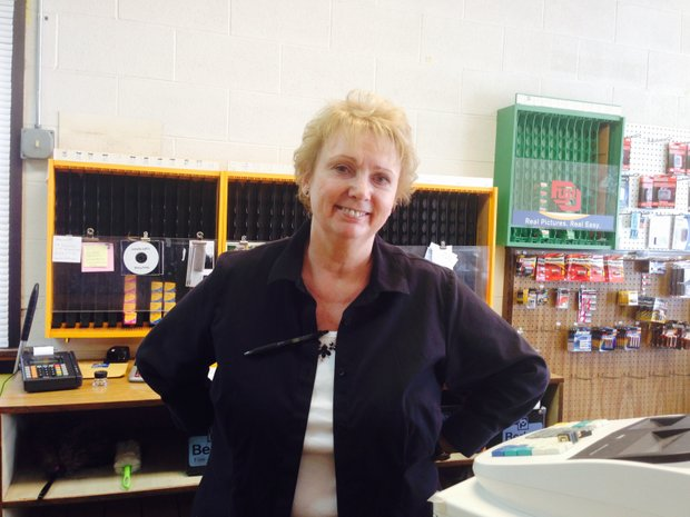 """Barbara Eberhard is overseeing the """"going-out-of-business"""" sale at her husband's store, Camera House West, in Joliet."""