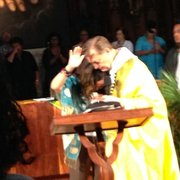 Father Michael Pfleger, pastor of  St. Sabina Church, comforts Lucia McBath,who lost a son to gun violence.