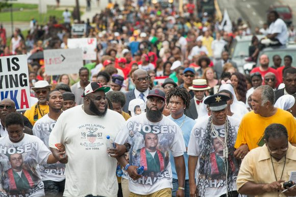 As another protest on Ferguson's beleaguered West Florissant Avenue began to turn rowdy, Jon Belmar was among the first to ...