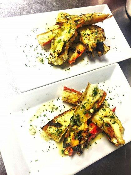 Grilled Alaska king crab tower  with garlic butter, lemon gelee