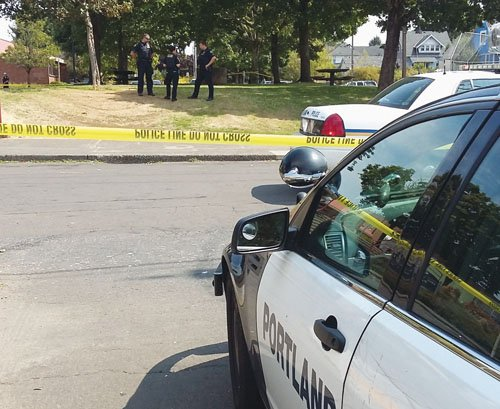 Police respond to a shooting at King School Park on Monday afternoon, where they found a young woman with a bullet wound to her hand.