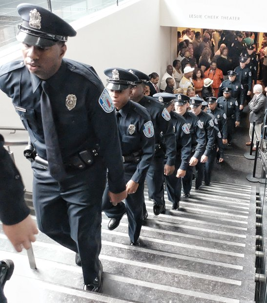 Proud graduates- Newly minted Richmond Police officers march from the Leslie Cheek Theater after being sworn in last Friday. Location: Virginia Museum of Fine Arts. The 30 officers are the city's 111th recruit class. They hail from Virginia and states from Connecticut to North Carolina. They completed 30 weeks of training. They will spend the next eight weeks gaining field experience under the supervision of a veteran officer. The new officers are helping to fill some of the vacancies in the police department's sworn contingent.