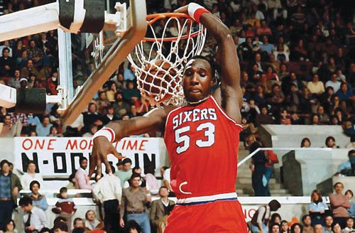 """Darryl Dawkins, whose board-shattering dunks earned him the moniker """"Chocolate Thunder"""" and helped pave the way for breakaway rims, is ..."""