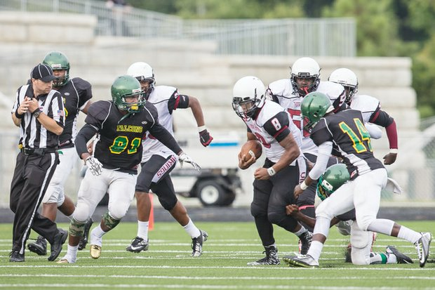 Huguenot linebacker Jameko Coleman (left, No. 81) goes after a Thomas Jefferson High School receiver during Saturday's season opener at the new Huguenot football stadium. Huguenot beat Thomas Jefferson 14-0