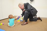 U.S. Senator Durbin visits with one of Metropolitan Family Services Calumet Center's childcare program participants.