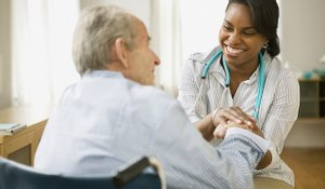 Home health aide worker with patient