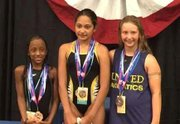 Nine-year-old Kennedy Stokes (left), won a medal for the 100 Breast at the annual AAU Junior Olympic Games that was held in Newport News, Virginia.