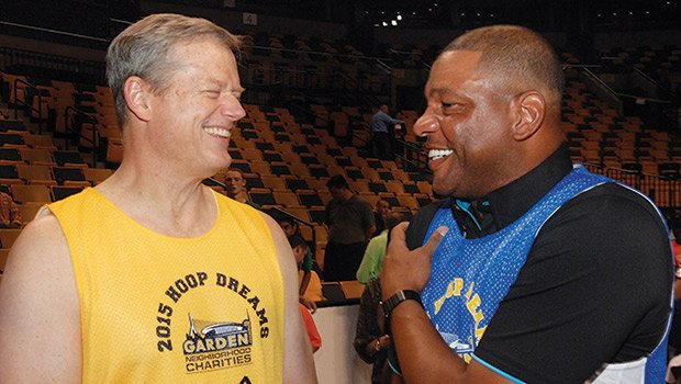 Los Angeles Clippers basketball coach Doc Rivers (right) chats with Gov. Charlie Baker during the annual Action for Boston Community Development Hoop Dreams event that raised funds for Greater Boston community programs. Rivers flew in from L.A. to help celebrate the 5th anniversary of the event at TD Garden and to join other supporters such as Boston School Superintendent Tommy Chang, Celtics coach Brad Stevens and sports writer Bob Ryan.