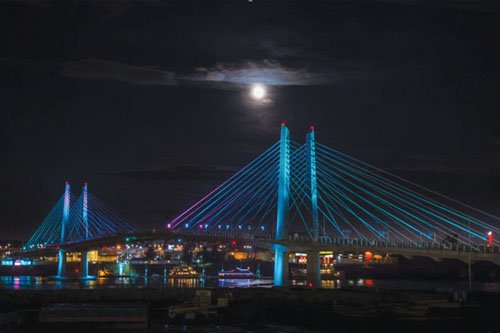 Portland's newest bridge over the Willamette River brightens the city's nighttime skyline with its aesthetic light program permanently switched on.