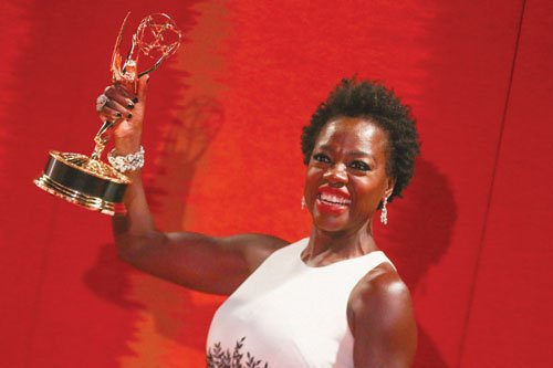 A long-standing barrier fell in the history of television at Sunday's Emmy Awards as Viola Davis became the first non-white ...
