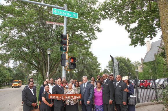 A portion of Richards Street will bear a sign with Bishop J.E. Moore's name in honor of his 50th year ...