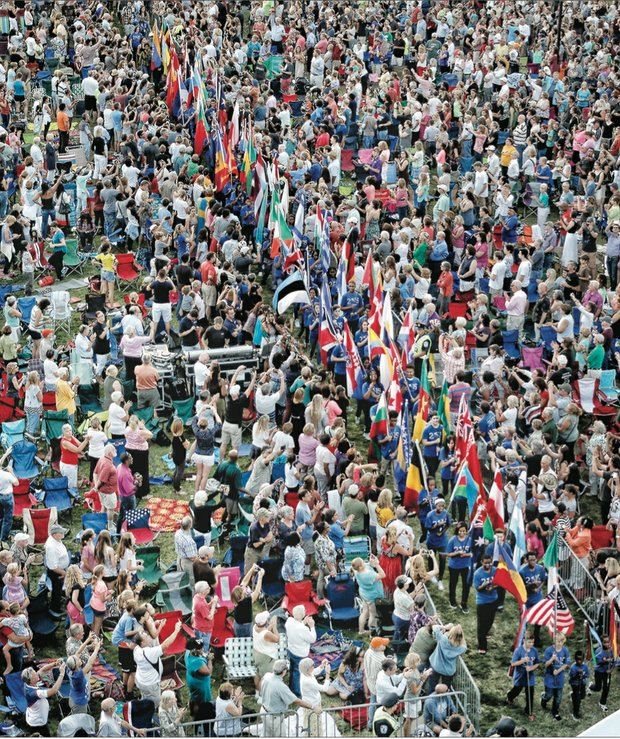 Thousands of spectators packed Brown's Island for the opening ceremonies of the UCI bike races, where students from Richmond Public Schools and surrounding counties carried flags representing the 74 participating countries.
