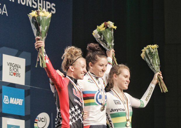 Sharing victory smiles, Team USA's Cloe Dygert, center, and Emma White, left, won gold and silver medals, respectively, Monday in