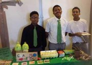 Green Street Academy students show off produce made possible through the urban agriculture component of the charter school's curriculum.