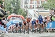 Cyclists make the grueling climb up the steep cobblestone hill Saturday on 23rd Street in the Women's Elite Road Race.