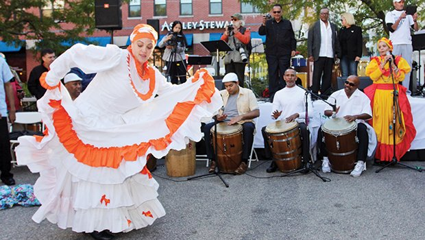 "Eli ""Lady"" Pabon of Boston-based Bomba Sankofa soloing to the barriles (Bomba drums) at the Plenazo y Bombazo in Dudley Square. This free outdoor event was organized by historian, educator and performer Jorge Arce of Humano Project with the support of Hibernian Hall & Madison Park CDC to celebrate the merging of cultures."