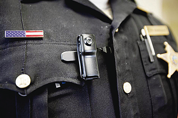 All NYPD patrol officers will wear body cameras by the end of 2018, officials announced Tuesday.