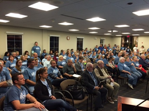 Members of the Community Chrisitian Church attended Monday's Plainfield Village Board meeting to support a special use approval for their new home in a former industrial building.