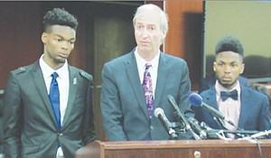 Jason Goolsby (right) with his attorney Peter Grenier and Jason's friend, Michael Brown (Courtesy of WJLA)