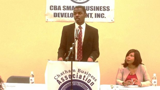 Alexander Buckles, Supplier Diversity Analyst for the McCormick Place in Chicago, speaks during the Chatham Business Association (CBA) monthly meeting on Tuesday, Oct. 13, 2015 as CBA Executive Director, Melinda Kelly listens in.