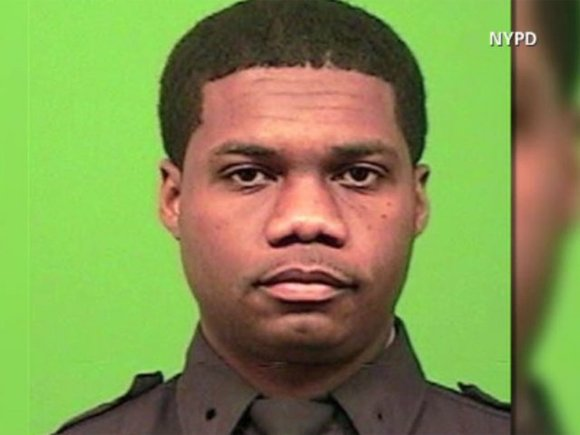 A New York police officer died after he was shot in the head Tuesday night while chasing a robbery suspect, ...