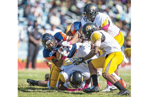 Virginia State University's Trenton Cannon fights for extra yardage in the Trojans' 22-19 homecoming game loss last Saturday to Bowie State University at Rogers Stadium.