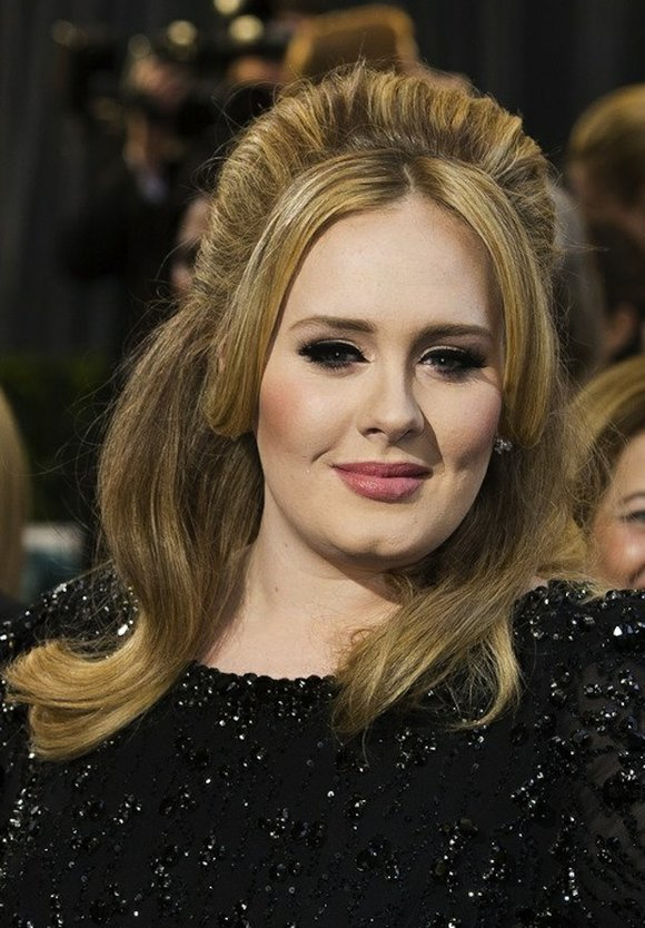 In a new Vanity Fair cover story, singer Adele discusses fame and also opens up about her struggles with postpartum ...