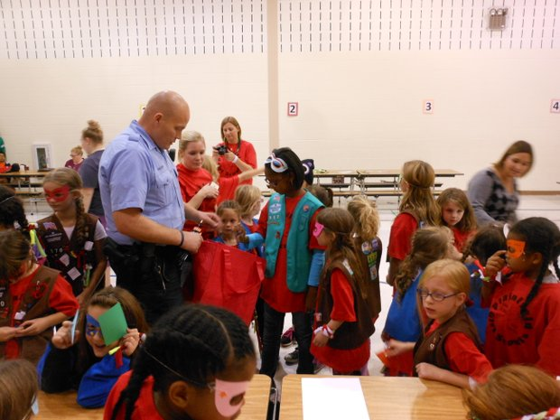 Joliet police officer Dwayne English talks to Charles Reed Girl Scouts about their pledge to stay drug free.