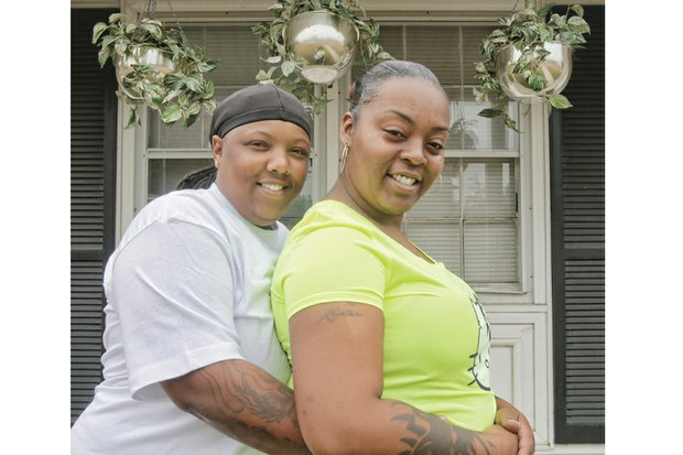 Shamika, left, and Kristea Fauntleroy affectionately embrace last week outside their Tappahannock home one year after Virginia legalized same-sex marriage, allowing the couple to exchange vows.