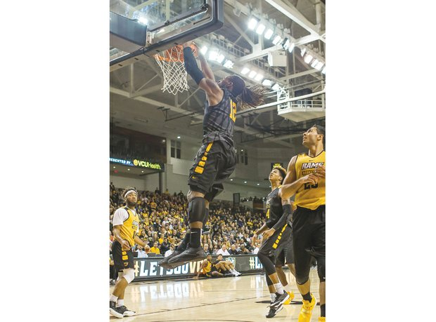 Junior Mo Alie-Cox dunks with authority during Virginia Commonwealth University's fan-packed Black & Gold Game last Saturday at the Siegel Center. The Black Team won the scrimmage 85-76.