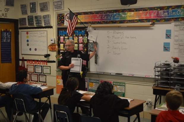 Shorewood D.A.R.E. officer Kim Giugler teaches a class of fourth graders at Shorewood Elementary School.
