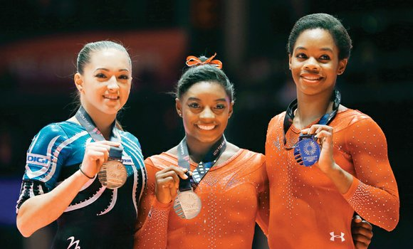 Simone Biles reigns as the queen of gymnastics. The 18-year-old American continued her dominance by winning her third straight world ...