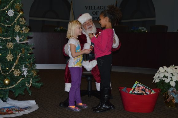 Shorewood kicked off the holiday season with its annual tree lighting ceremony and a visit from Old St. Nick on ...