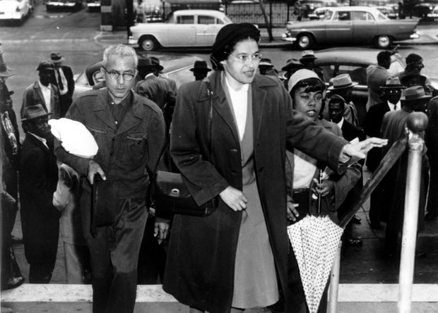 Rosa Parks arrives at the Montgomery, Ala., courthouse with supporters to be arraigned following her arrest Dec. 1, 1955, for refusing to move to the black section in the rear of a city bus. African-Americans then began a boycott of the bus company that lasted for more than a year.