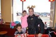 Officer Dan Dougherty with Mailyah and Gabriella Shop with a Cop.