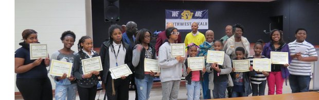 Elementary and middle school students received academic achievement certificates and $100 gift cards on Dec. 5 at Commissioner Stan Watson's community breakfast.
