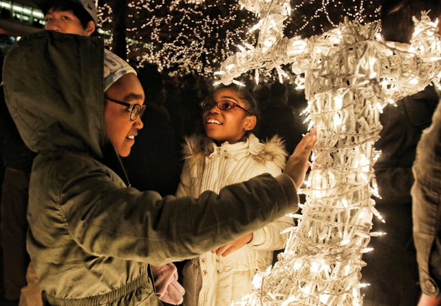 Devaney, left, and Andera Davis of Chesterfield County are wowed by a lighted reindeer on the holiday scape.