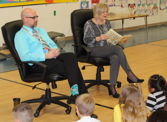 Principals in the Troy Craughwell Elementary School help foster a love of reading by showing their love of books each ...