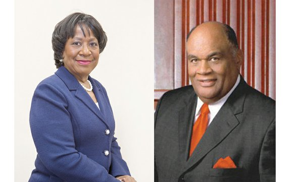 Eddie N. Moore Jr. is wreathed in smiles, while Dr. Pamela V. Hammond is frowning. That's how the interim presidents ...