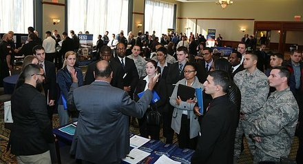 Group Shot at DEA Booth - Tony Jennings addressing a highly attended booth.