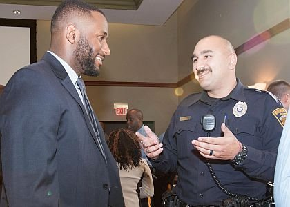 Justin Glover, a Law and Justice Major at Rowan University speaking with Matthew Martinez, Patrolman for the Woodbury City Police Department.