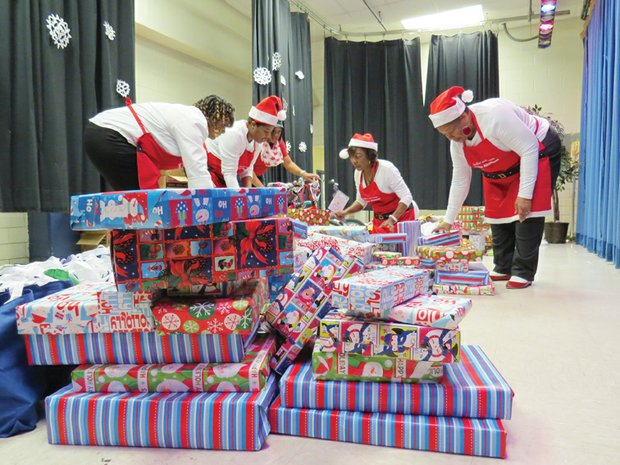 The annual Breakfast With Santa event of the Decatur Alumnae Chapter of Delta Sigma Theta brought gifts, Christmas stories and a hot pancake breakfast to kids in Clarkston on Dec. 12.