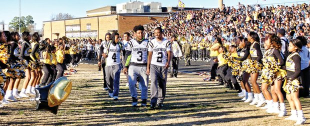 Springer players, from left, Greg Dortch, D.J. Anderson and Chris Thaxton lead teammates onto the field at Highland Springs High as cheerleaders and community members salute them as No. 1 in the state.