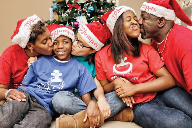 United by love and wearing their JP JumPers Foundation Santa hats, the Mines family gets into the holiday spirit Wednesday at their Chesterfield County home. The family, from left, mother, Pam Mines; 11-year-old son, J.P.; adopted godniece, Sydnee, 13; daughter, Michelle, 13; and father, Perry Mines.