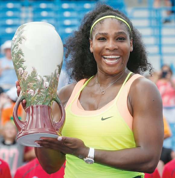 Serena Williams, who held all four of tennis' grand slam titles for the second time in her career and won ...