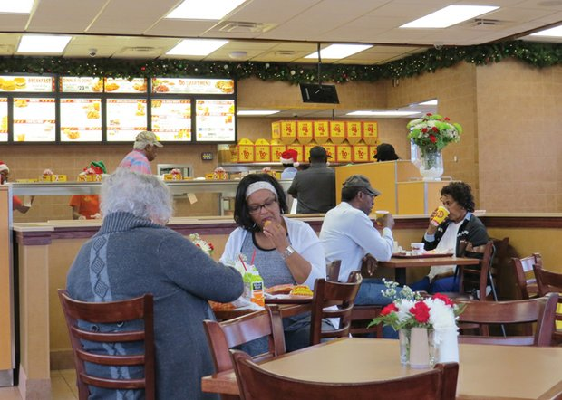 Customers like Deborah Simmons rave about the food at DeKalb's first Bojangles' Famous Chicken 'n Biscuits, on Panola Road in Lithonia.