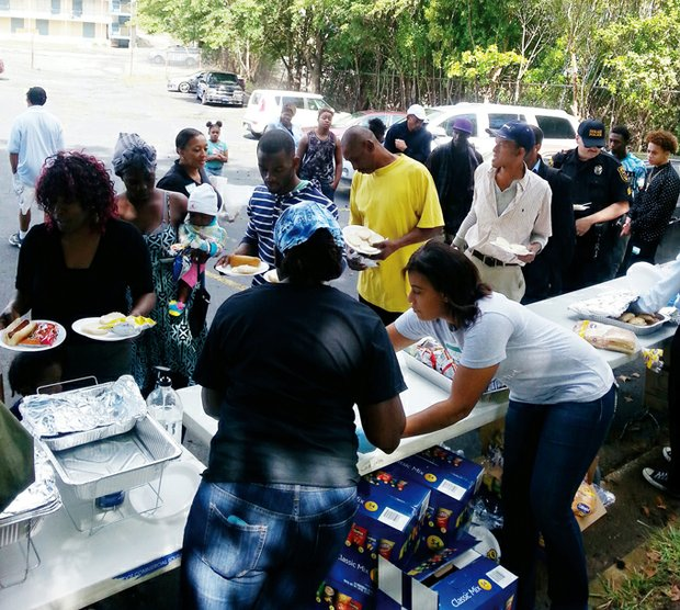 Police, community volunteers, and religious organizations fed 225 people, including 55 kids, at an Oct. 10 cookout at the A2B Hotel on Ember Drive.