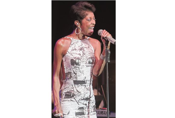 Grammy Award-winning singer Natalie Cole, whose biggest hit came in a virtual duet with her late father, the legendary Nat ...